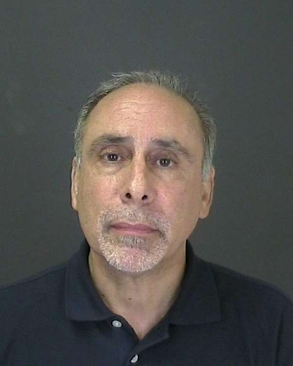 Albert J. Carini pleaded not guilty to grand
