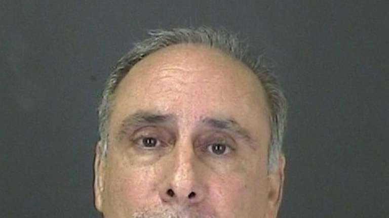 Albert J. Carini pleaded not guilty to grand