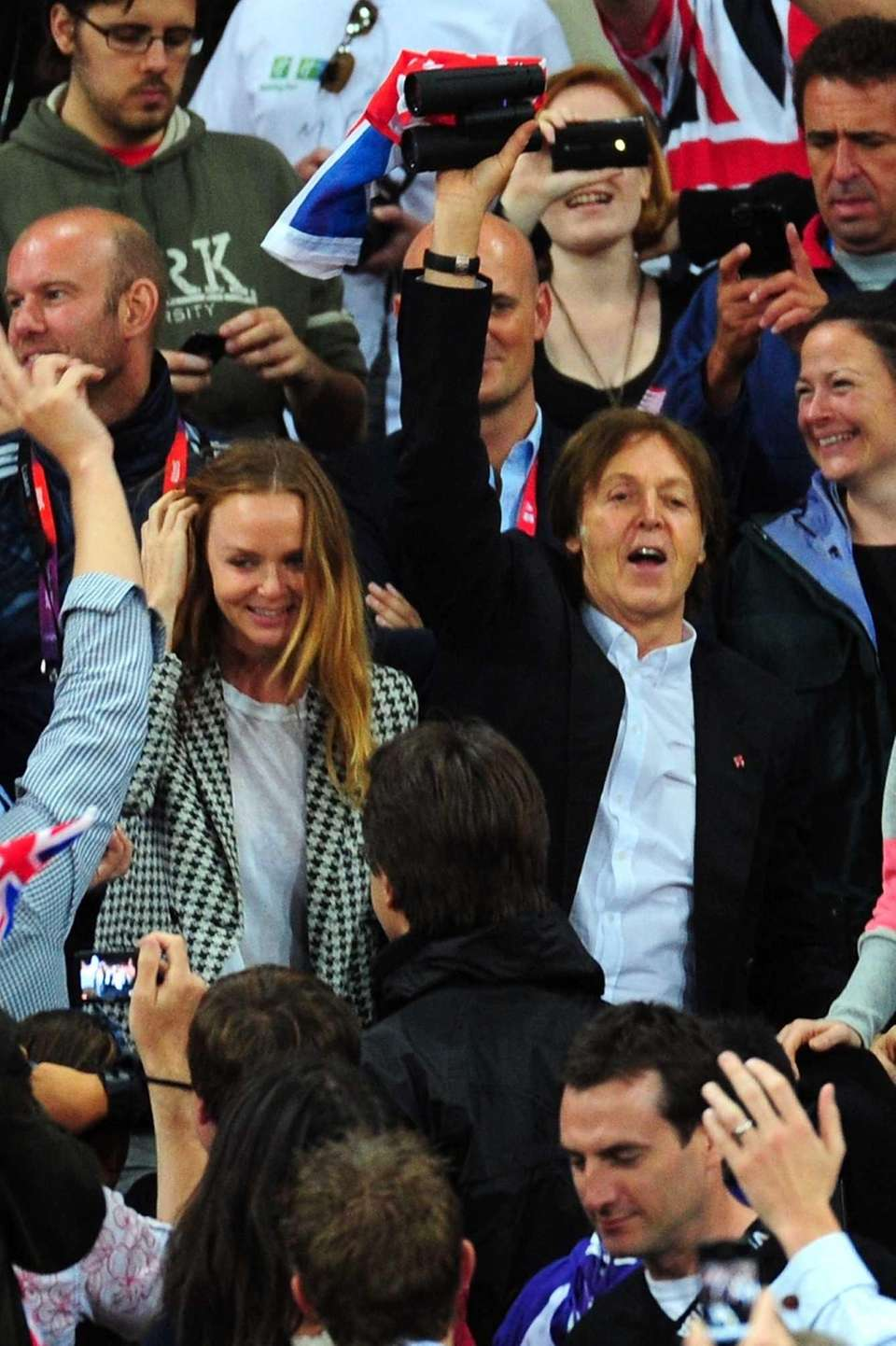 Designer Stella McCartney and Paul McCartney cheer on