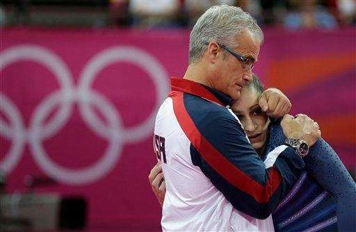 U.S. gymnast Jordyn Wieber is consoled by head
