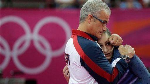 U.S. gymnast Jordyn Wieber is consoled by head