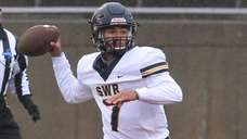 Shoreham-Wading River QB Xavier Arline throws a pass