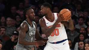 Knicks forward Julius Randle is defended by Nets