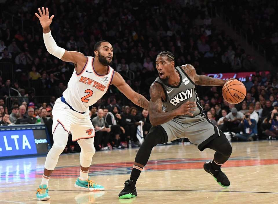 Brooklyn Nets guard Iman Shumpert is defended by