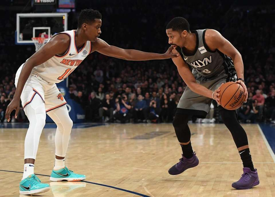 Brooklyn Nets guard Spencer Dinwiddie is defended by