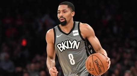 Nets guard Spencer Dinwiddie dribbles the ball upcourt