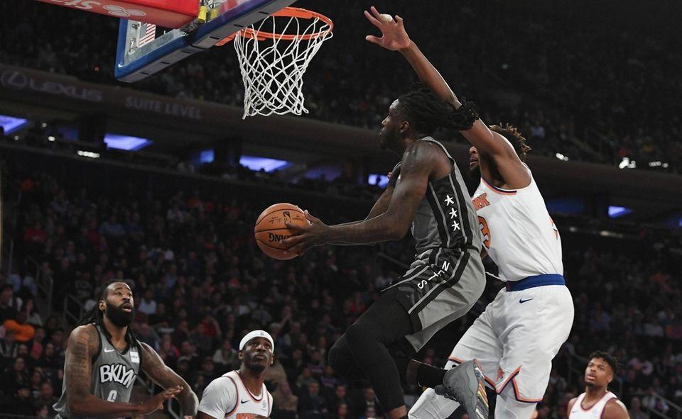 Brooklyn Nets forward Taurean Prince puts up a