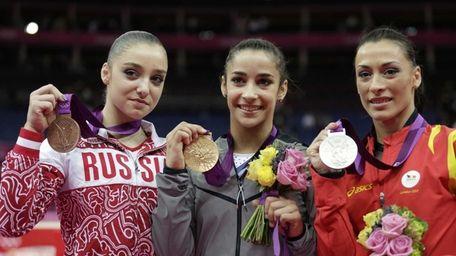 U.S. gold medallist gymnast Alexandra Raisman, center, Romania's