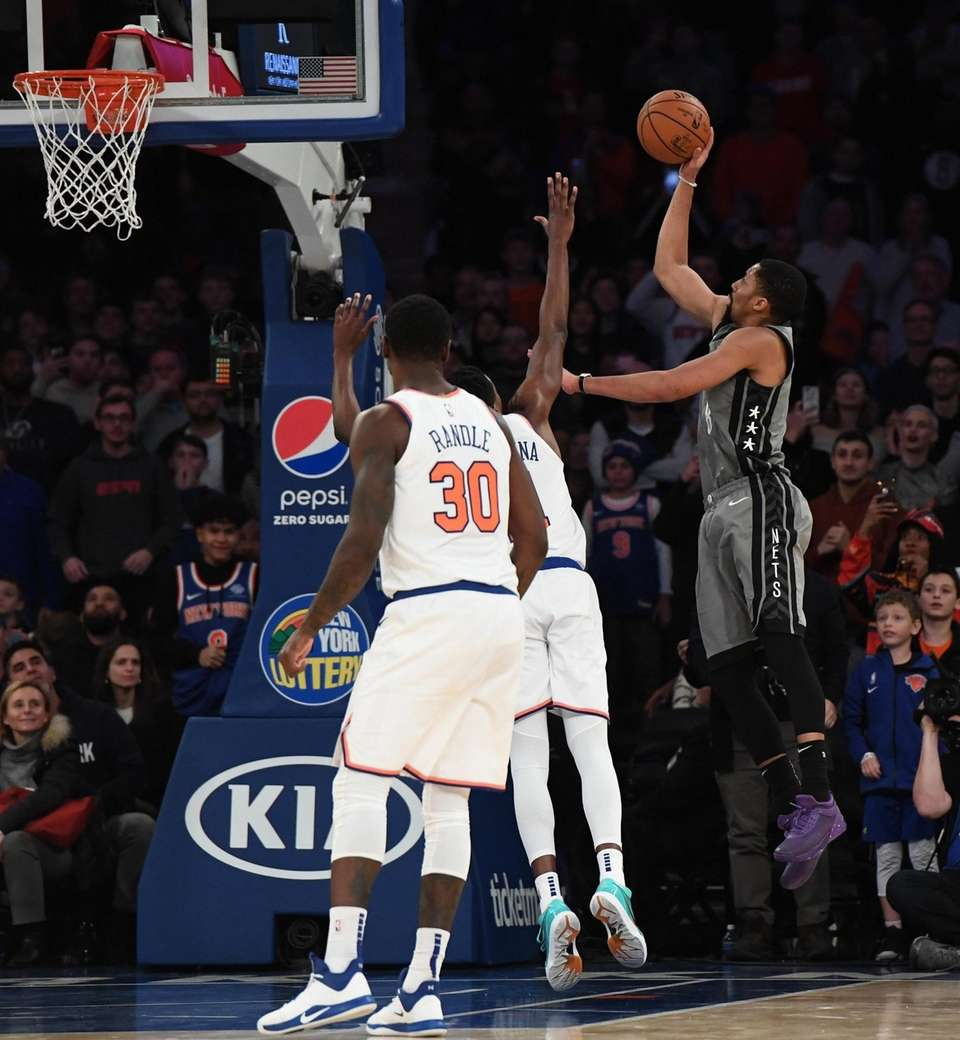 Brooklyn Nets guard Spencer Dinwiddie shoots for a