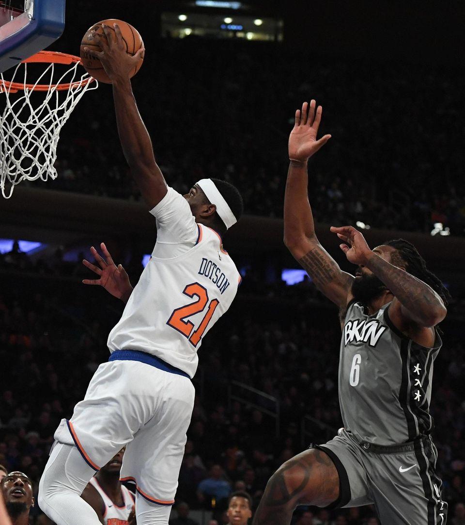 New York Knicks guard Damyean Dotson puts up