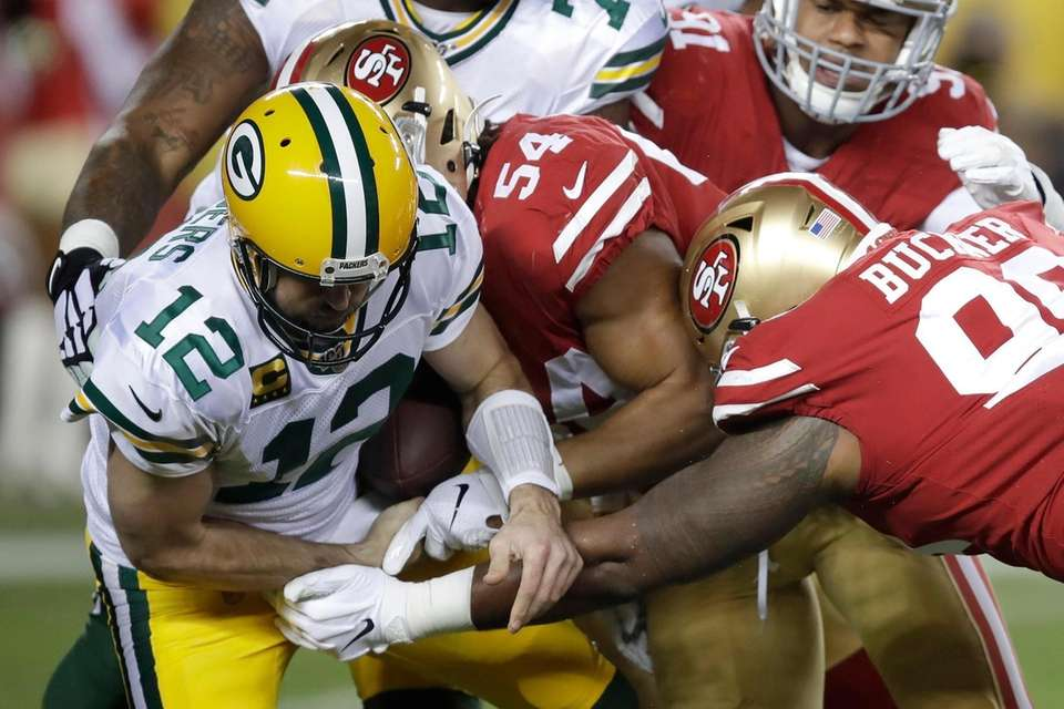Green Bay Packers quarterback Aaron Rodgers fumbles the