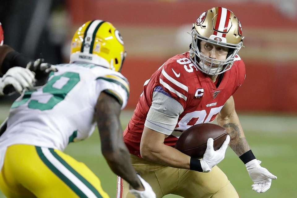 San Francisco 49ers tight end George Kittle, right,