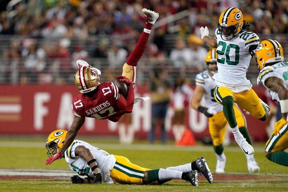 San Francisco 49ers wide receiver Emmanuel Sanders falls