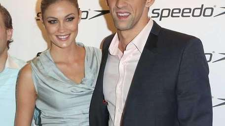 Megan Rossee and Michael Phelps (Photo by Tim