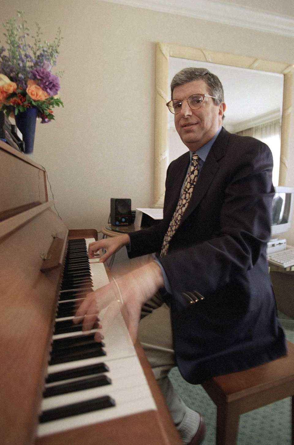 Composer Marvin Hamlisch plays the piano in a