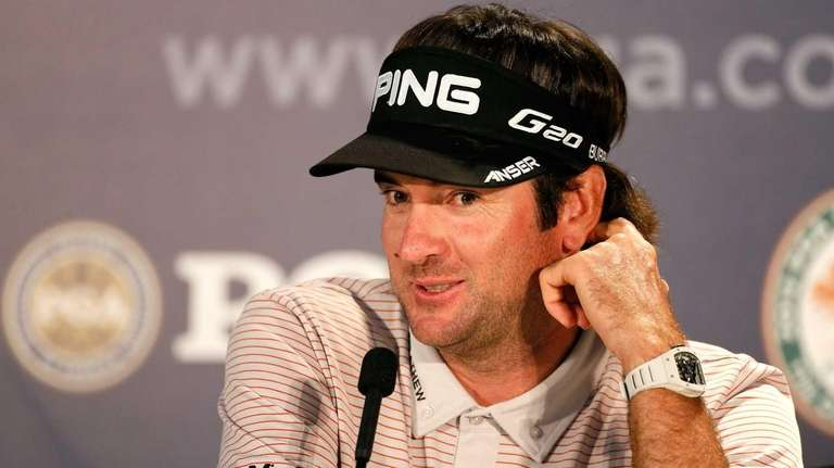 Bubba Watson speaks during a press conference before