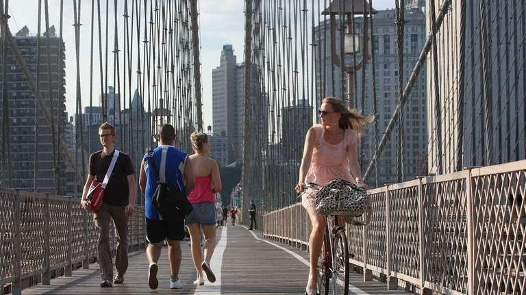 NEW YORK - AUGUST 25: A cyclist crosses