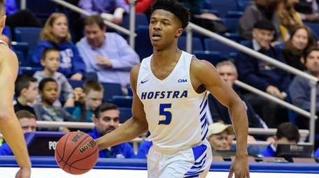 Hofstra guard Eli Pemberton brings the ball up