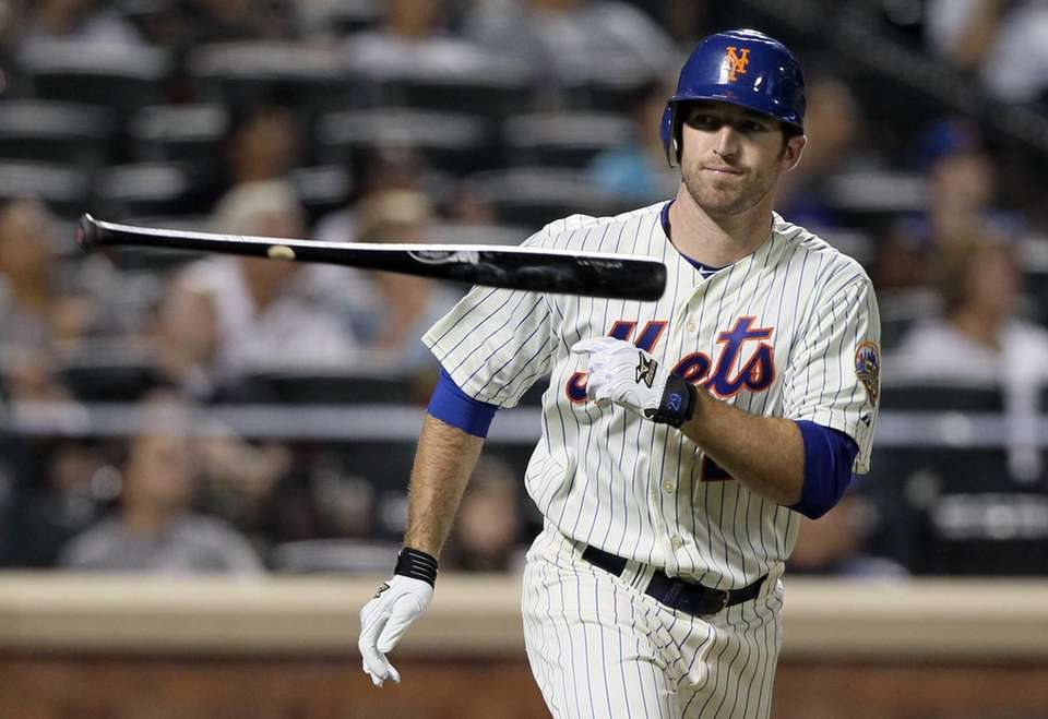 Ike Davis throws his bat after flying out