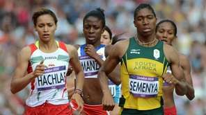 South Africa's Caster Semenya (R) and Morrocco's Halima