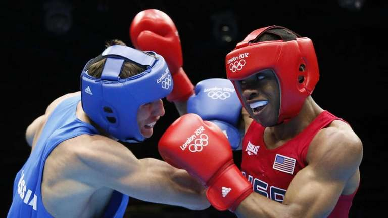 Errol Spence of the USA (in red) fights