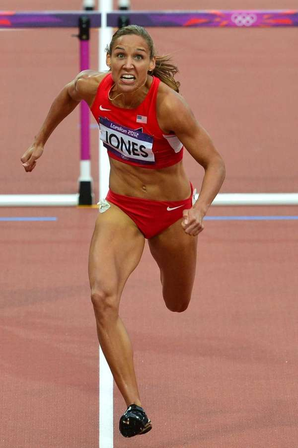 Lolo Jones competes in the women's 100m hurdles