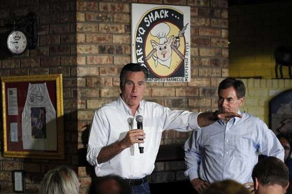 Republican presidential candidate Mitt Romney campaigns with Richard