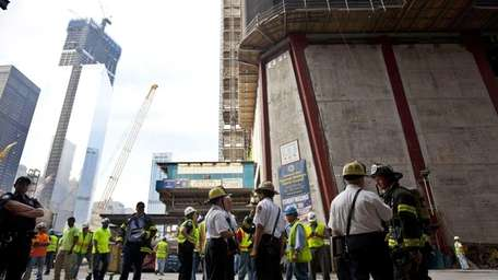 New York City firefighters gather at the base