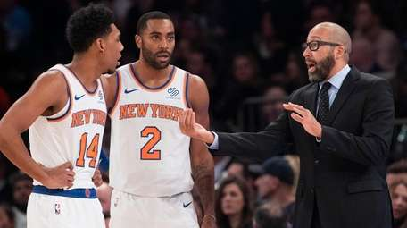 Knicks coach David Fizdale, right, talks to guard