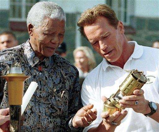 Arnold Schwarzenegger, right, and former South African President