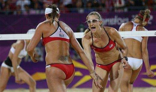 Kerri Walsh Jennings, right, and Misty May-Treanor react