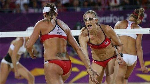 Kerri Walsh Jennings, right, and Misty May-Treanor react