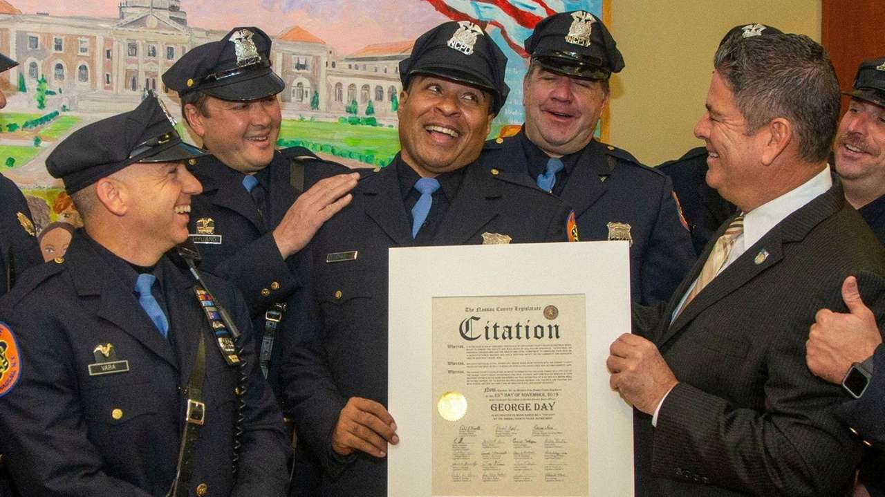 Nassau legislators honored Nassau police Officer George Day