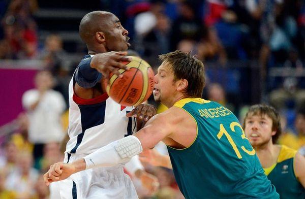 Kobe Bryant passes the ball around the head