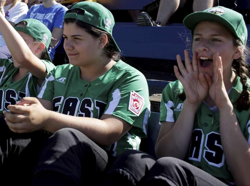 Teammates cheer as pitcher Jenny Hickey (not pictured),