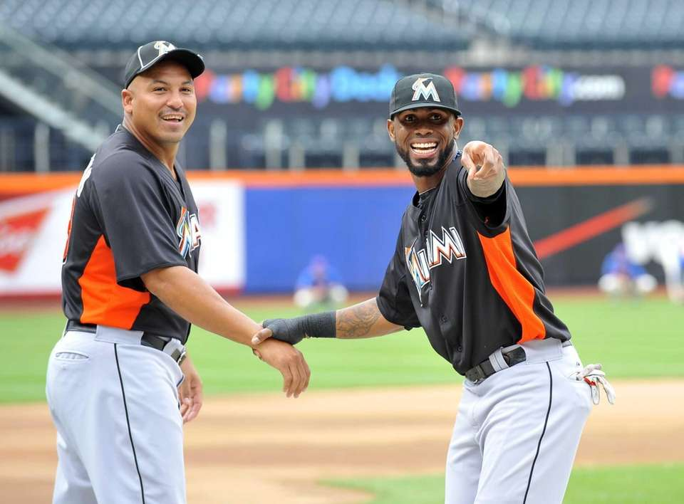 Jose Reyes, right, points out someone in the