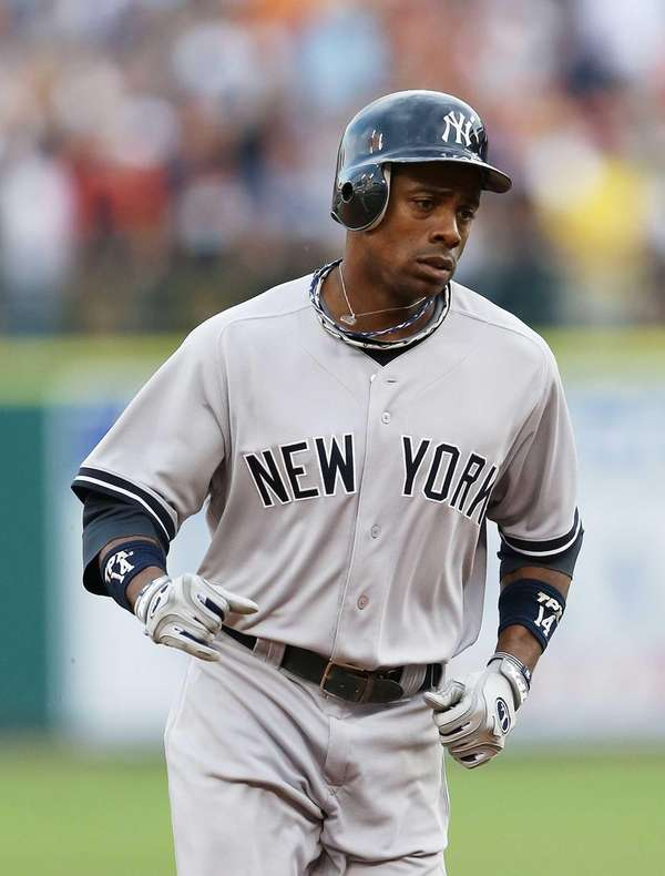 Curtis Granderson rounds the bases after hitting a