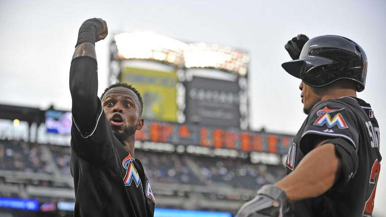 Jose Reyes, left, and Giancarlo Stanton celebrate Stanton's