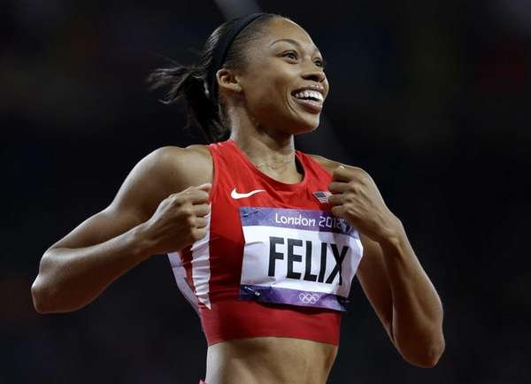 Allyson Felix celebrates her win in the women's