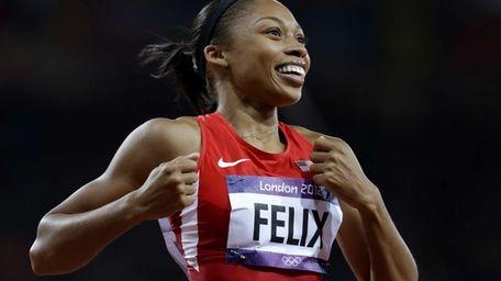 Allyson Felix celebrates her win in the women's