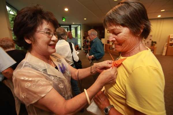 Symbolizing peace, Mychiko Tani of Port Washington, pins