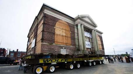 The Carnegie Library starts its move from the