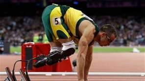 South Africa's Oscar Pistorius prepares to run in