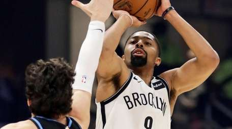 The Nets' Spencer Dinwiddie shoots over the Cavaliers'