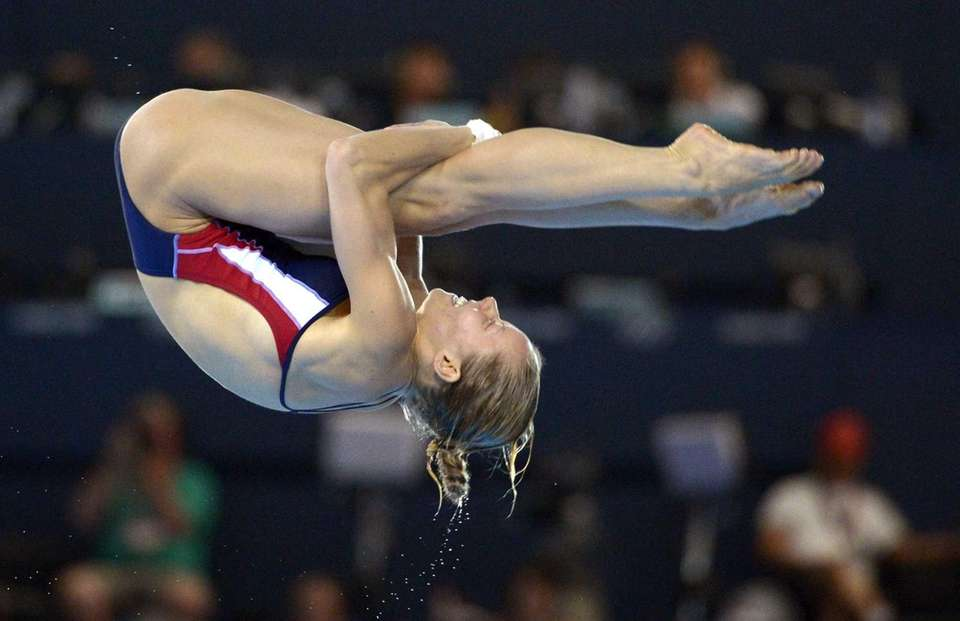 Brittany Viola of the United States dives during