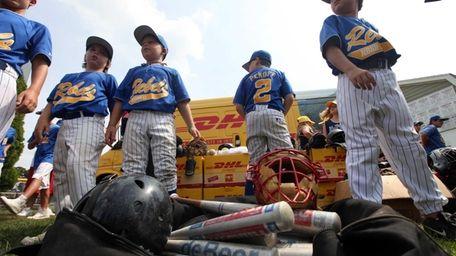 A pile of hundreds of baseball equipment items,
