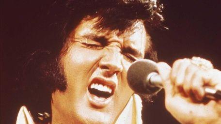 Photo of Elvis Presley performing live onstage at