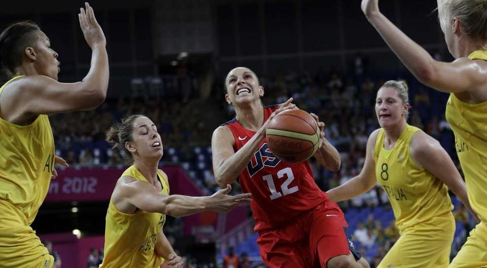 USA's Diana Taurasi (12) drives past Australia's Jenna