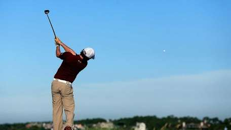 Rory McIlroy of Northern Ireland hits off the