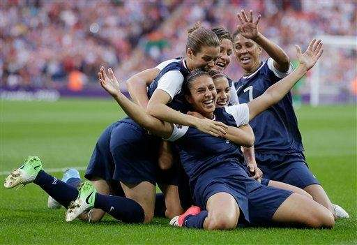 United States' Carli Lloyd, right, celebrates with teammates